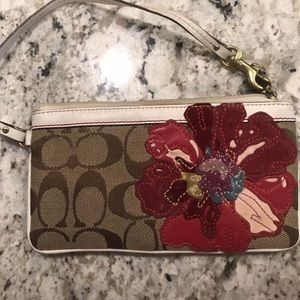 Coach wristlet with poppy design on front